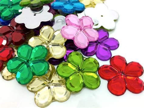 16 multi coloured flower shaped flat back acrylic