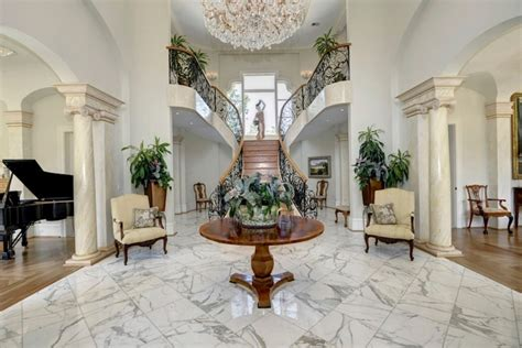 Large Foyer Chandelier Soft Textured Marble Tile Flooring Designs With Round