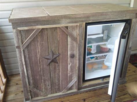 deck cabinet with refrigerator open door tile top