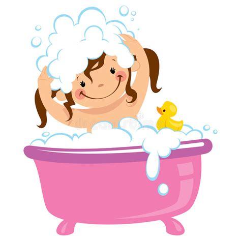 bathing a baby in a bathtub baby kid girl bathing in bath tub and washing hair stock