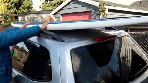 How To Put Surfboard On Roof Rack by How To Tie A Surfboard Or Sup To A Car With Roof Rails