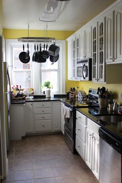 yellow kitchen dark cabinets white cabinets and wall color solutions for kitchen 20
