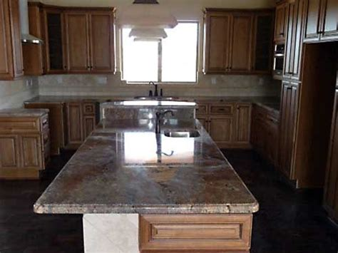 Water Damaged Kitchen Cabinets Coffee Glazed Maple Cabinets With Granite Light Tile Backsplash Water Damage Repair Ideas