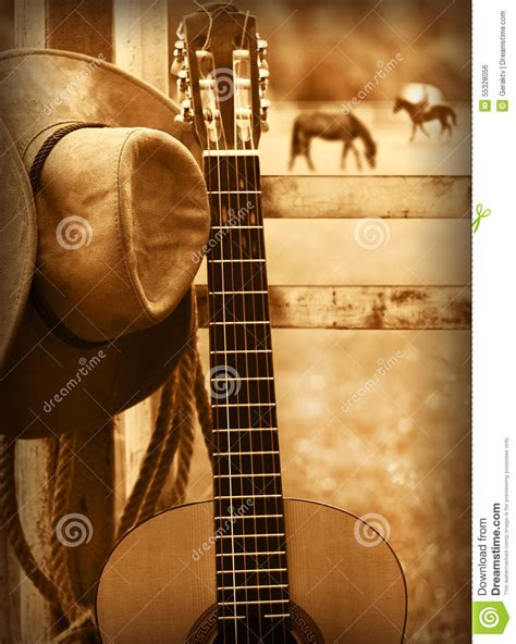 country music songs on guitar cowboy hat and guitar american music background stock