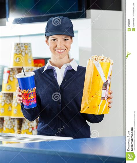 happy worker holding popcorn and drink cinema stock photo