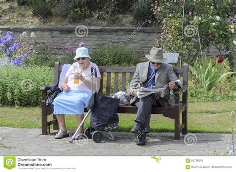 couple on park bench an old marriage couple sitting in the park editorial