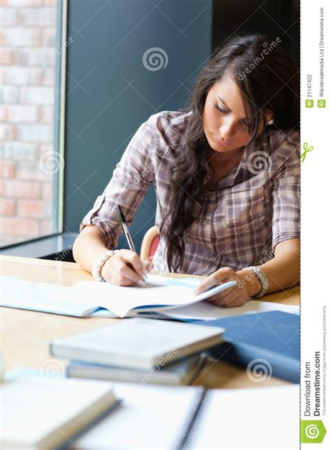 Student Writing Essay by Portrait Of A Beautiful Student Writing An Essay Stock Photo Image 21147422