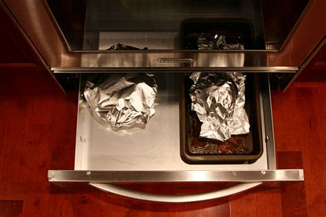 bottom drawer on oven purpose what s the purpose of an oven drawer popsugar food