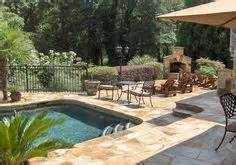 mountain lake pool idea with wall and raised patio