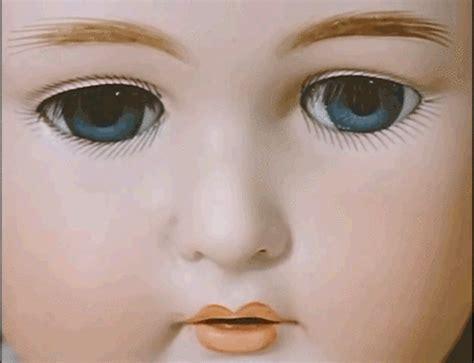 creepy doll gif