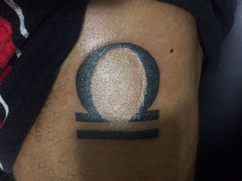 50 libra tattoos to keep you balanced in your search for