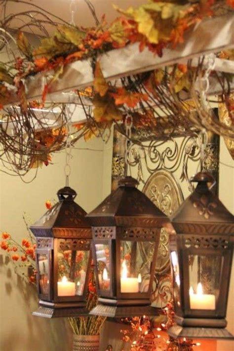 lanterne con candele decorare casa in autunno foto design mag