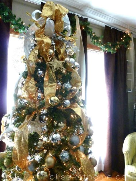 gold ribbons on christmas trees silver and gold tree thinking about doing this with the ribbons season