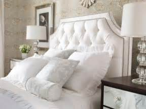 picture of framed white nailed tufted headboard