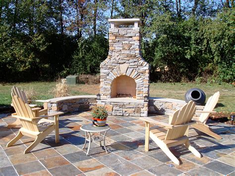 custom designed outdoor rooms wood fireplace kitchen