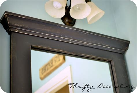 framing your bathroom mirror thrifty decorating frame your bathroom mirror