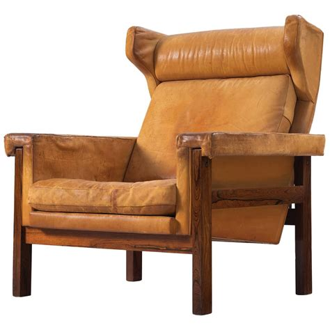 cognac leather wingback chair wingback chair in solid rosewood and patinated