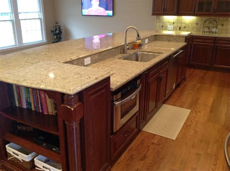 island kitchen sink a 12 island contains the sink dishwasher and microwave drawere it also provides seating