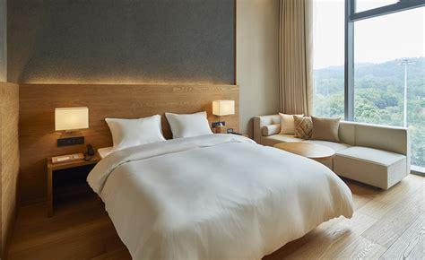 muji brings  masterfully minimalist aesthetic  hotels