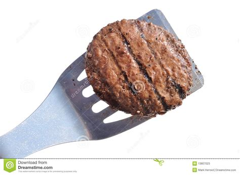 Spatula Burger grilled hamburger patty on a spatula stock photos image
