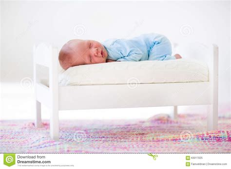 baby sleeping bed little baby sleeping in toy bed stock image image 63017025