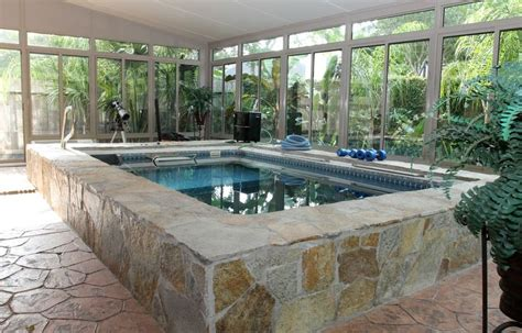 endless lap pool stone finishing and a wrap around garden view give a