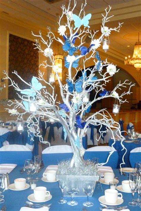 silver tree centerpiecesilver tree centerpiece with blue butterflies hanging tea lights