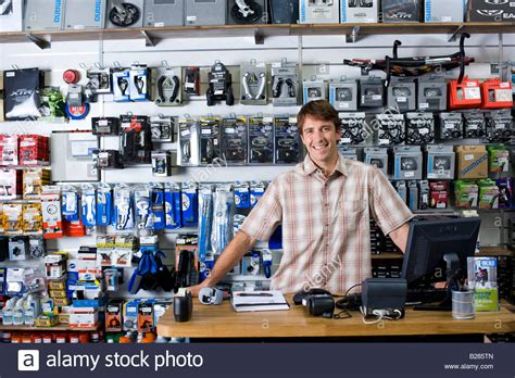 shop assistant counter smiling portrait stock photo royalty free image 18619909 alamy