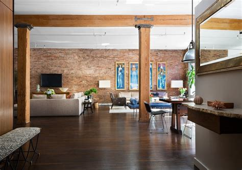 studio homes brick wall studio apartment by stephan jaklitsch gardner open plan exposed beam living