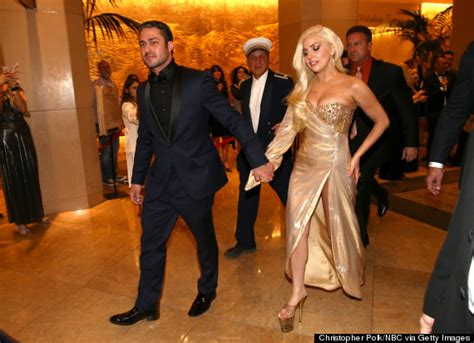 lady gaga and hunky boyfriend taylor kinney attend golden