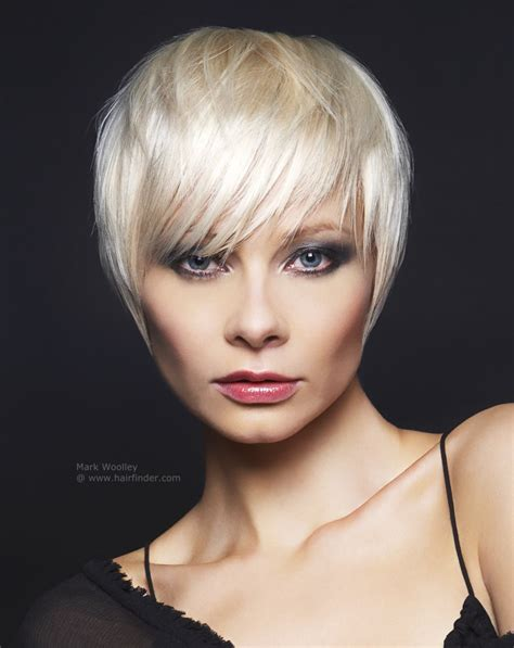 hair cut with a defined point in the back platinum short hairstyles fade haircut