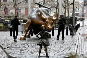 bull le statue stands up to iconic wall bull