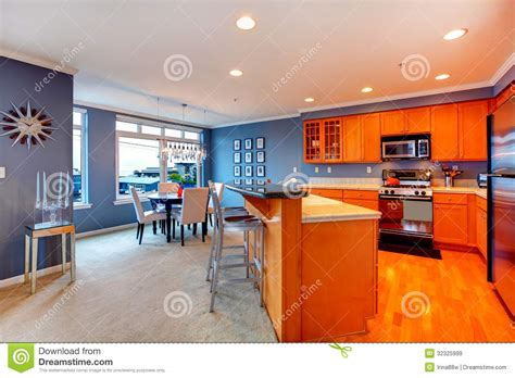 Kitchen Cabinets Molding Ideas city apartment orange wood kitchen interior stock image