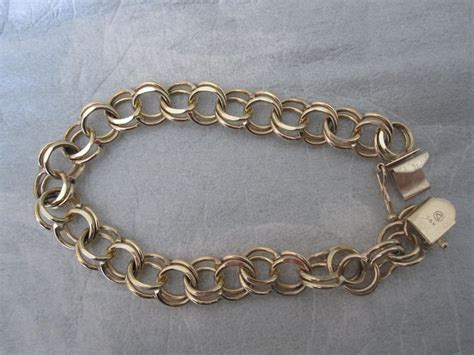 stunning 14k gold link charm bracelet from