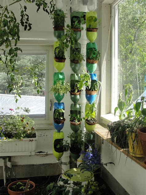 colorful vertical garden made out of recycled soda bottles