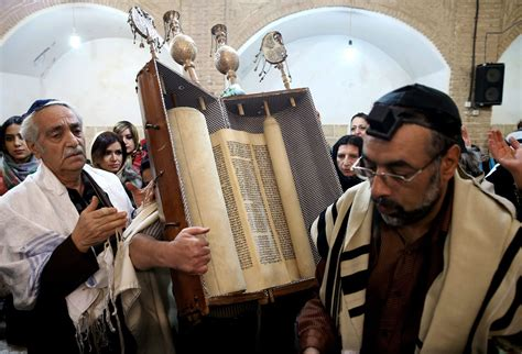 Find In Iran An Iranian Holds A Torah Scroll At The Molla Agha Baba Synagogue Yazd 676