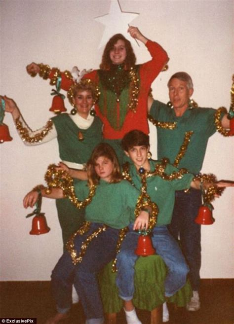 And baubles strike awkward poses to create a human christmas tree