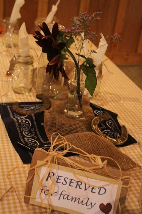 Our wedding table decor. Rustic horseshoes, blue bandana