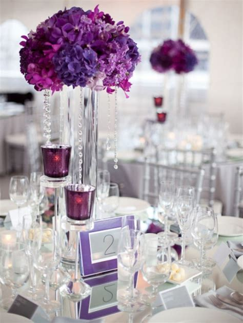 floral purple and silver wedding centerpiece with