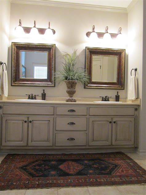 Painting Bathroom Cabinets Ideas these painted bathroom cabinets and the lights what