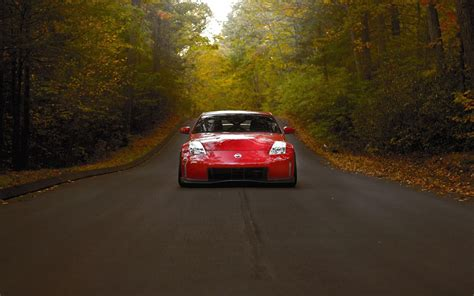 nissan  red car road fall forest hd