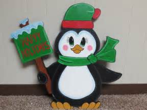 christmas penguin with happy holidays sign wood by chardoman