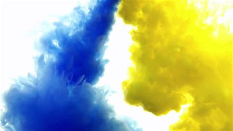 blue and yellow ink in watercreative slow motion on a