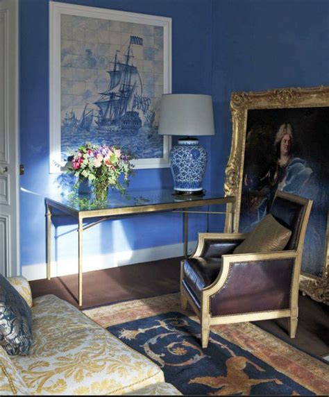regency style living room with cornflower blue walls and