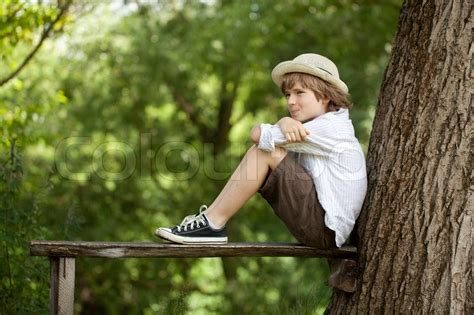 bench boys boy sits on a bench stock photo colourbox