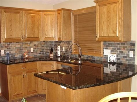 Honey Oak Kitchen Cabinets With Black Countertops / design