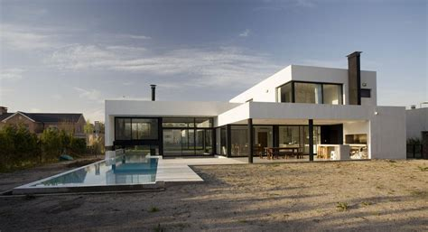 black and white house with modern glass building blackwhite residence home building grand bell house by andres remy arquitectos keribrownhomes