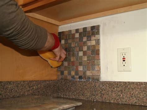 how to install a glass tile backsplash in the kitchen installing kitchen tile backsplash hgtv