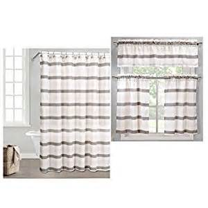 green shower curtain and 3 pc window