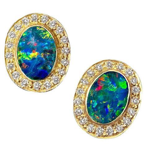 Handmade Opal Jewelry - handmade fiery boulder opal halo gold stud